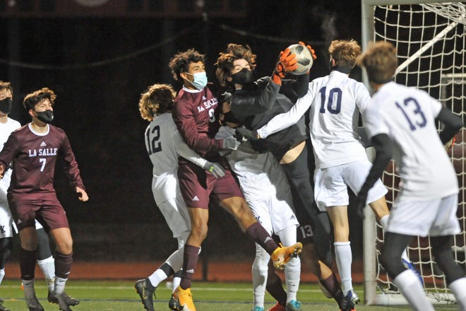 South Kingstown goalie Colin O'Grady comes down with the catch in traffic after a La Salle corner kick during the second half of Wednesday's Division I boys semifinal.