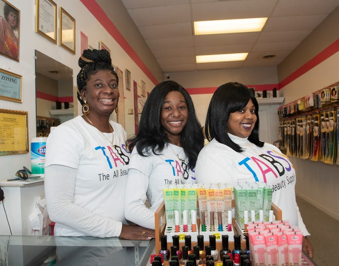 The All Beauty Supply Store in Streetsboro opened recently. Shown are Tiffany Marcy, with her daughter Saniyah Henderson, 15, and co-owner niece, Shanece Henderson.