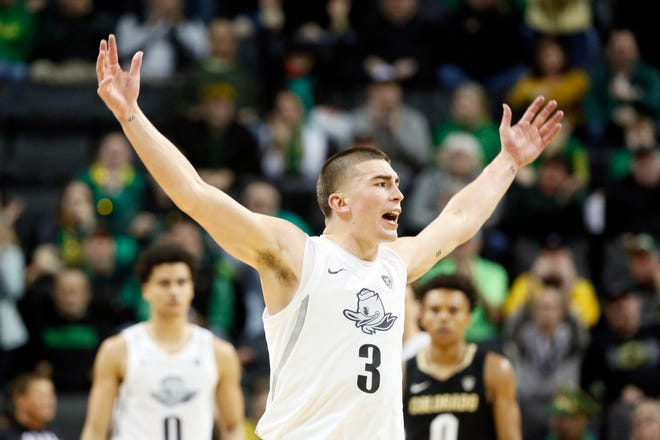Oregon's Payton Pritchard reacts after hitting a shot during the second half of a comeback win over Colorado on Feb. 13 at Matthew Knight Arena.