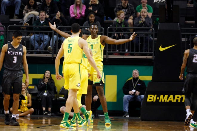 Oregon's N'Faly Dante celebrates with Chris Duarte (5) after a dunk in a Dec. 18, 2019, home win over Montana.