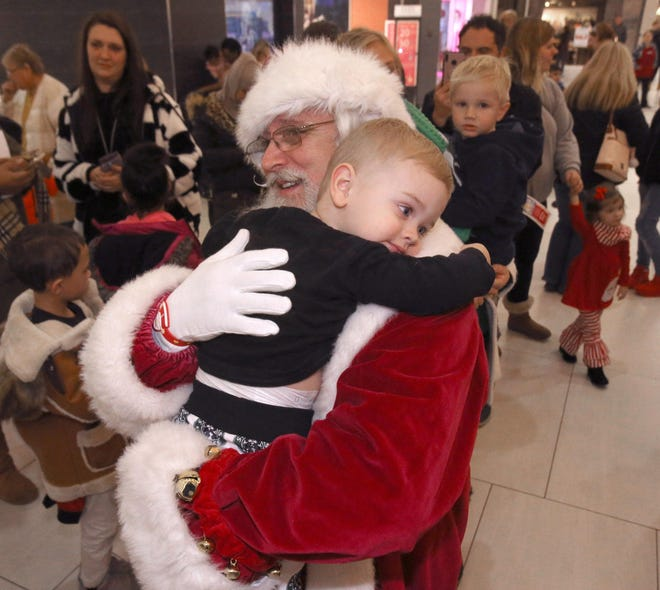 Santa gets a hug from Lincoln Riccio at Belden Village Mall in Jackson Township on Thursday, Nov. 14, 2019. (CantonRep.com / Scott Heckel)
