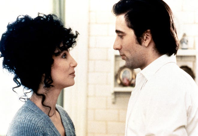 """American actress and singer Cher and actor Nicolas Cage on the set of """"Moonstruck."""""""