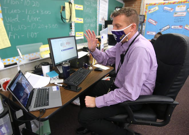 Bret Blackstock waves goodbye to AJ Eicherly who was learning remotely with his fifth-grade class at Sauder Elementary in Jackson Township. Jackson Local Schools is one of the only Stark County school districts that allows students to switch from online to in-person classes at any given time.