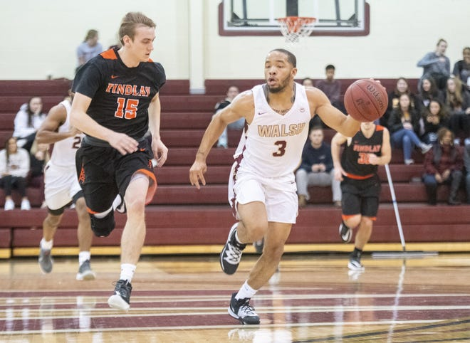 Walsh's Darryl Straughter, right, shown here in a game against Findlay last season, hit six 3s and scored a game-high 24 points in Sunday's 86-60 win over the No. 6 Oilers.
