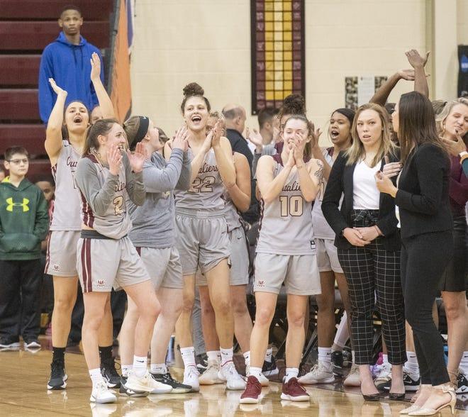 The Walsh women's basketball team celebrates winning the G-MAC finals Saturday, Mar. 7, 2020. (CantonRep.com / Aaron Self)