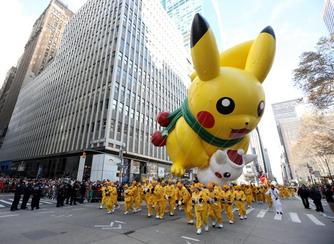 The Pikachu balloon makes its way down Sixth Avenue in Manhattan during the annual Macy's Thanksgiving Day Parade on Nov. 28, 2019.