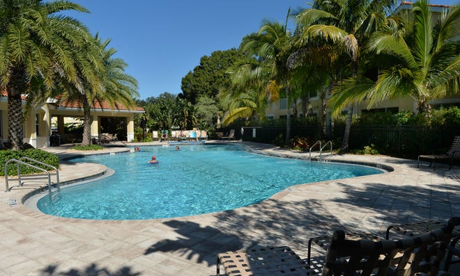 Residents of Bay Street Village Condominiums in Osprey can enjoy a resort-style community pool, cabana and fitness center.