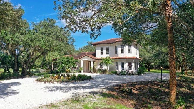 This 10-acre private estate in Osprey, Sarasota, is on the market for $4.8 million. The two-bedroom, two-bath home has a Country French aesthetic with a red barrel tile roof and white, artistically textured stucco exterior.  (Pix360)