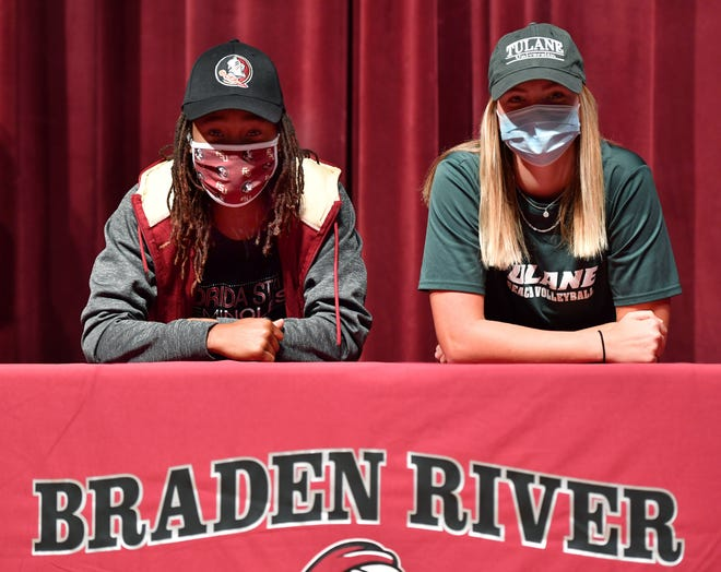 Braden River High held a ceremony Wednesday for two student athletes to sign national letters of intent. O'Mariah Gordon, left, will attend Florida State University on a women's basketball scholarship and Sara Hall will attend Tulane University on a beach volleyball scholarship.