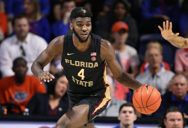 Florida State forward Patrick Williams brings the ball up Nov. 10, 2019, in Gainesville, Fla. Williams was selected by the Chicago Bull in the NBA draft.