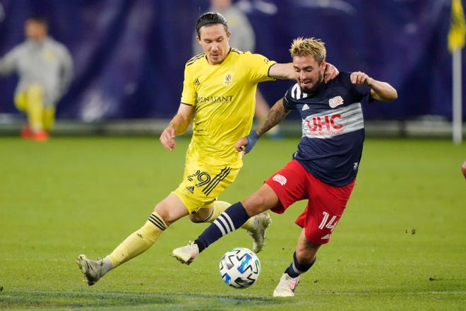 New England's Diego Fagundez is chased by Nashville SC's Alex Muyl during a game earlier this season.