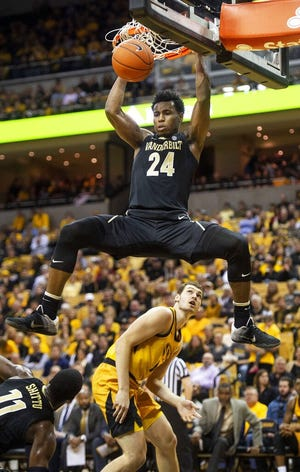 FILE - Vanderbilt's Aaron Nesmith (24) dunks the ball over Missouri's Reed Nikko, bottom, during the first half of an NCAA college basketball game in Columbia, Mo., in this Saturday, Feb. 2, 2019, file photo. Nesmith is a possible pick in the NBA Draft, Wednesday, Nov. 18, 2020. (AP Photo/L.G. Patterson, File)