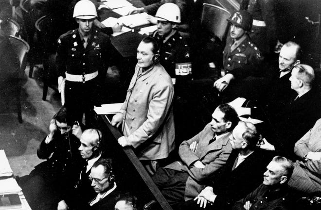 In this Nov. 21, 1945, file photo, Reichsmarshal Hermann Goering stands in the prisoner's dock at the Nuremberg War Crimes Trial in Germany.