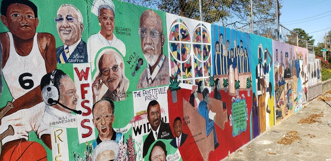 The Wall of Honor mural on Langdon Street is across from Fayetteville State University. A 27-year project, the mural 'shows stories about a neighborhood — its people, values, traditions and culture,' according to a pictorial book about it.