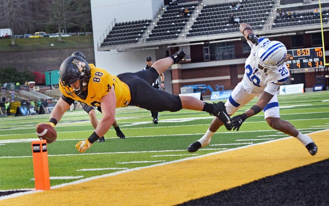 Appalachian State tight end Henry Pearson dives for the endzone pylon for a touchdown after getting past Georgia State's Quavian White during an NCAA football game, Saturday, Nov. 14, 2020, in Boone, N.C. (Walt Unks/Winston-Salem Journal via AP)