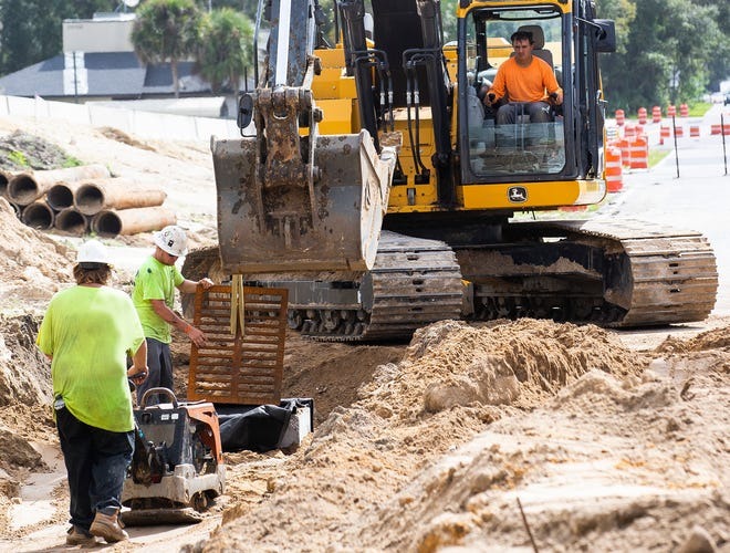 A construction crew works on a road project.