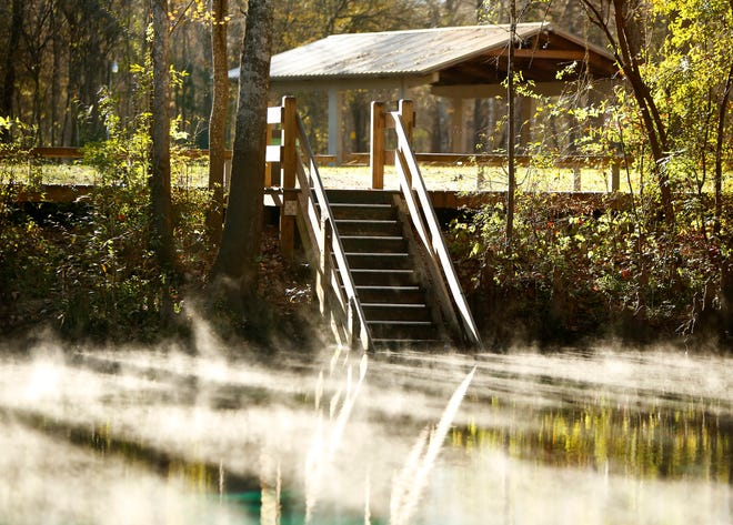 Steam wisps across the surface of Ginnie Springs at the campground in High Springs in 2018. An administrative judge recently ruled that Seven Springs Water Co. met requirements to pump water from the Ginnie Springs aquifer for Nestle.
