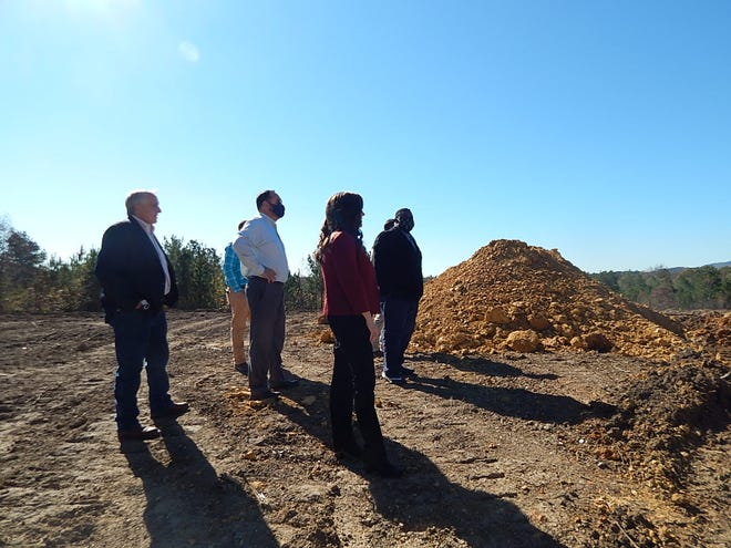 Etowah County Commisson members Johnny Grant,  Jeffery Washington and Craig Inzer Jr., Industrial Development DIrector Marilyn Lott, CAO Shane Ellison, and Assistant County Engineer Robert Nail look over what they hope will be the sight of a major industry in Etowah County's future.