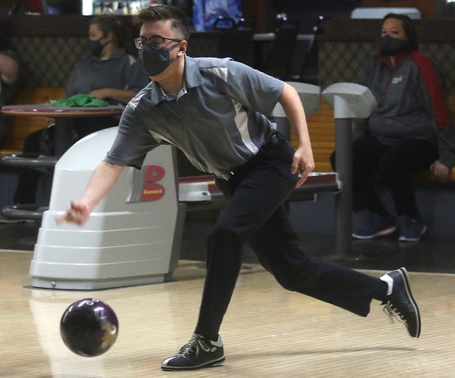 Dover's Brody Morris fires one in the New Philadelphia at Dover bowling match Thursday at Wabash Lanes.