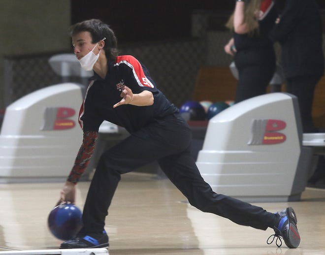 New Philadelphia's Blaze Bacon delivers a shot in the New Philadelphia at Dover bowling match at Wabash Lanes Thursday.