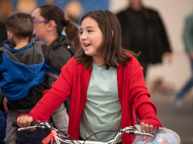 Mariah Sanchez, 10, smiles after receiving a bicycle at last years annual Christmas party for students of Bessemer area schools.
