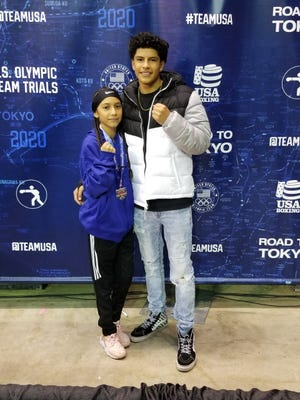 Iveth Alvarez, left, posses with her brother Isaac following a boxing tournament in 2020.