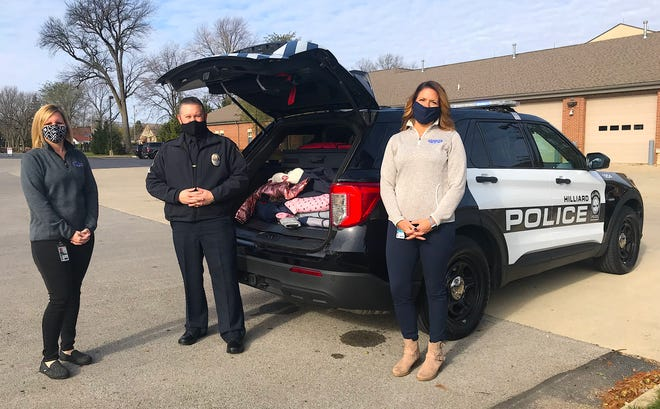 """Hilliard's second """"Cram the Cruiser"""" donation drive will be held in conjunction with theannual tree-lighting event from 4 to 7 p.m. Sunday, Dec. 6,at Weaver Park. Those involved include from Kristan Turner (left), recreation supervisor for the Hilliard Recreation and Parks Department; Hilliard Division of Police Sgt. Kris Settles; and Angela Zody, economic-development administrator for Hilliard."""