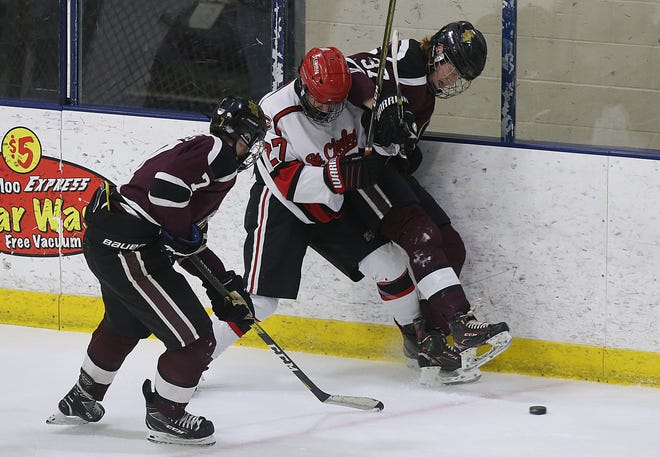 Junior Tristan Fahs (center) is among the leaders of a veteran St. Charles defense. The Cardinals are working to improve on last year's finish of 24-10-3-1 overall and 11-3-1-1 in theCHC-Red Division.