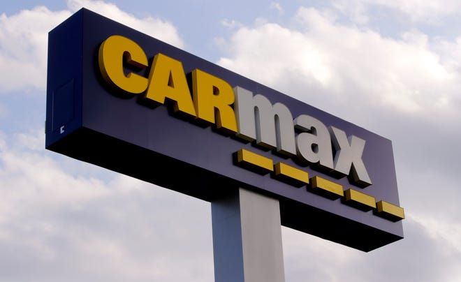 A sign at the CarMax dealership in Manchester, N.H., from 2019. A proposed CarMax in Victorville drew opposition from local auto dealers during a City Council meeting on Tuesday, Nov. 17, 2020.