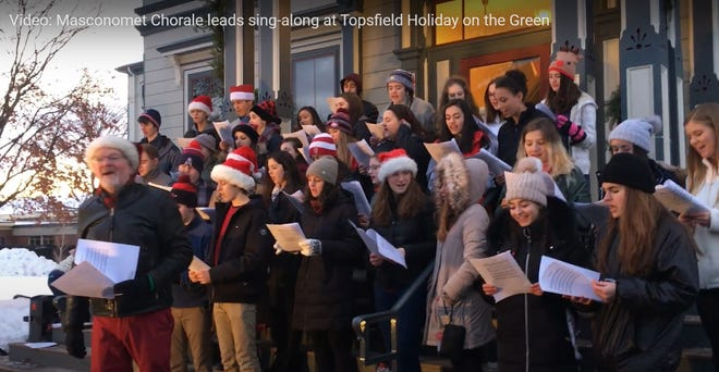 Screen shot from a video of The Masconomet Chorale performing on the steps of Topsfield Town Hall during the 2019 Holiday on the Green. The 2020 event will be virtual because of the COVID pandemic.