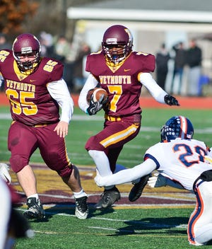 Weymouth's Christian Quinn leaps to avoid Walpole's Ethan Kelly's tackle during the last Thanksgiving Day game held at Weymouth High School in 2018.  [Patriot Ledger File Photo]