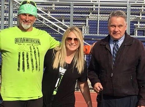 Rep. Chris Smith (right) with Jim and Karen Raffone at the end of Jim's 260-mile charity walk last month.