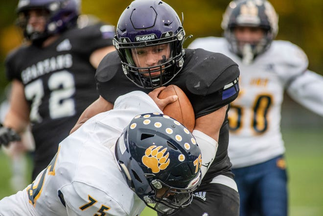 St. Joseph senior Joseph Brown (75) attempts to tackle Lakeview senior Jaden Simonson (8) on Friday, Oct. 23, 2020 at Lakeview High School in Battle Creek, Mich.