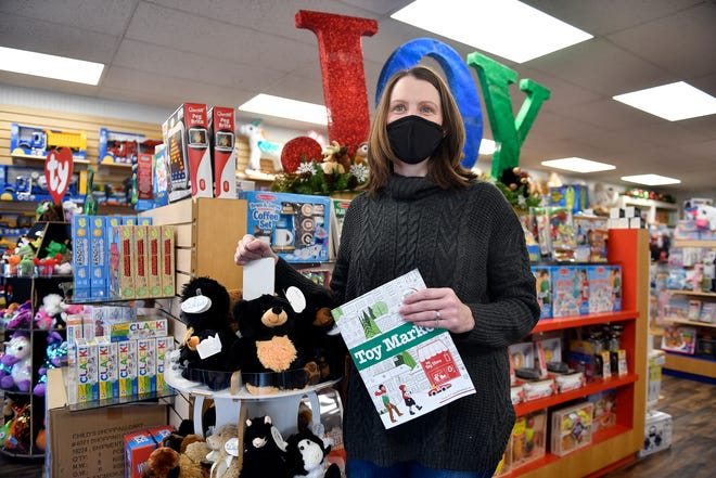 Kelly Donio, owner of Toy Market in Downtown Hammonton, N.J., offers several unique shopping options to ensure customers feel safe during the holiday season. Nov. 18, 2020.