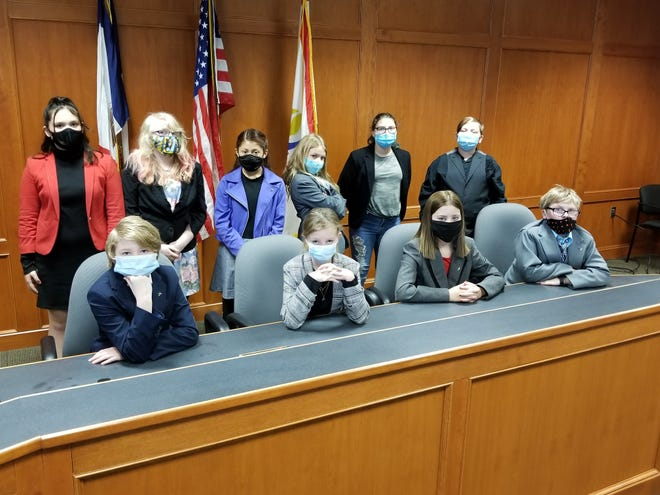 The Woodside Middle School Mock Trial Team, Don't Fire Us, Hire Us, Saydel Community School District. Pictured from left to right (seated), Deeja Coe, Audrie Sleeth, Amelia Peck, Jayden Wilcoxon; (standing) Aurora Olopwi, Piper Mash, Alejandra Carrillo, Ruby Thompson, Ana Marentes Gonzalez, and Jason Lage. Mock Trial Advisor is Mrs. Cheryl Smith. Woodside Middle School, Saydel Community School District, Nov. 16, 2020.