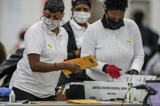 Absentee ballots are processed by election officials in the Detroit Elections Department Absentee Ballot counting room at TCF Center in Downtown Detroit on Wednesday, Nov. 4, 2020.