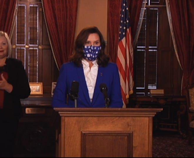 Gov. Gretchen Whitmer appears at a news conference on Nov. 19, 2020.