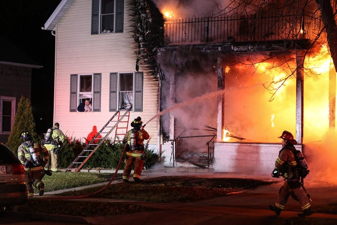 Fond du Lac Fire/Rescue members tend to a house fire on Nov. 19 at 159 West Arndt St. in Fond du Lac. City voters will be asked next April whether to fund six additional full-time firefighter/paramedics and six additional full-time police officers.