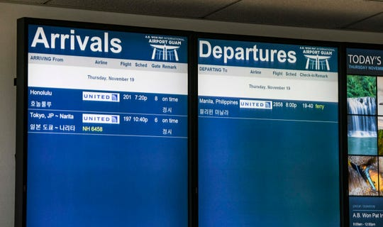 A flight status display shows just how few flights are scheduled to arrive and depart from the Antonio B. Won Pat International Airport in this Nov. 19 file photo.