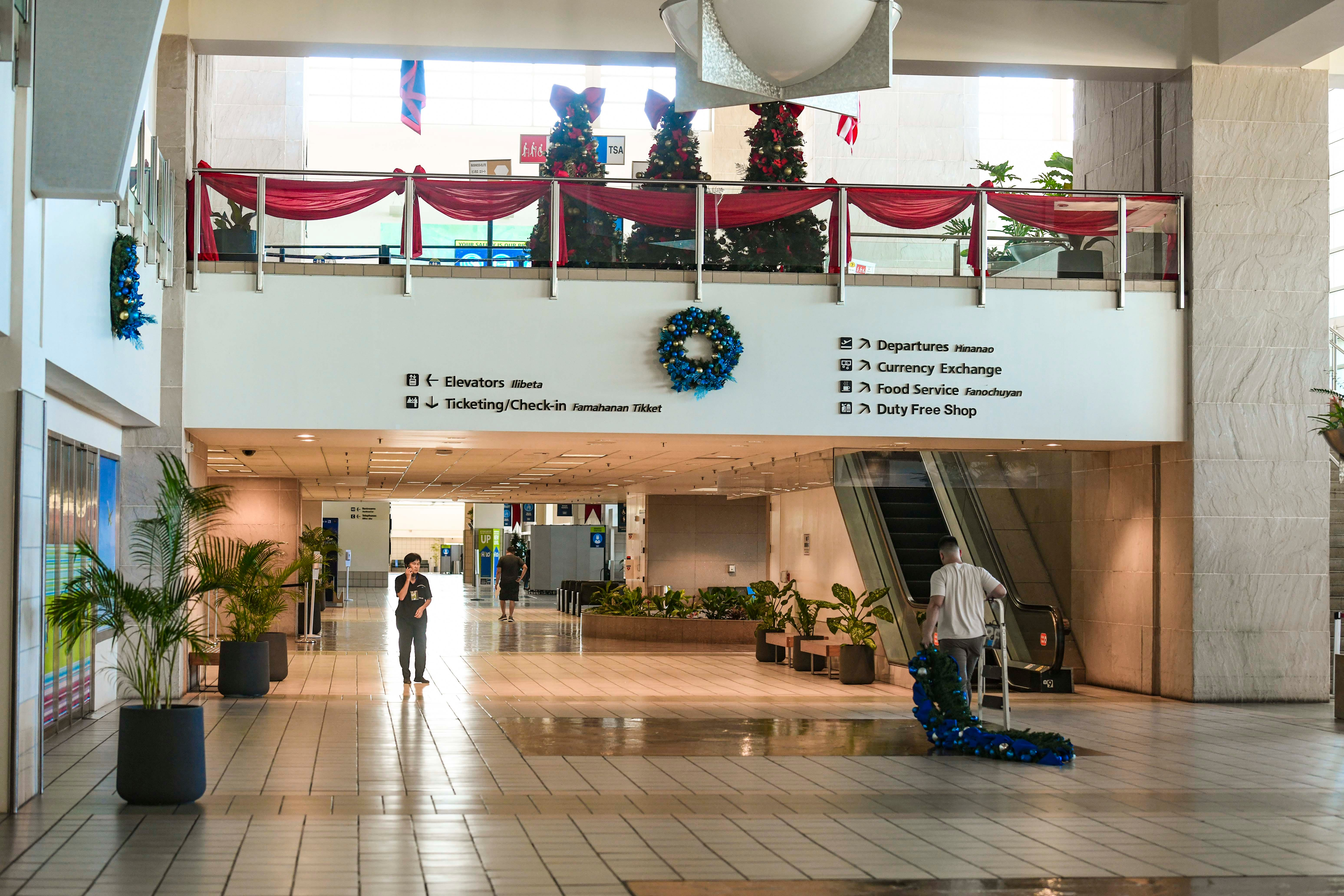 A few airport workers are all that could be found in an almost barren stretch of hallway within the Antonio B. Won Pat International Airport on Thursday, Nov. 19, 2020.
