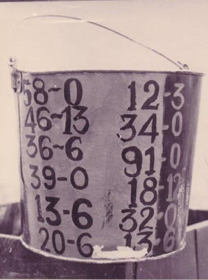 The water bucket that was claimed every year beginning in 1923  by the winner of the Thanksgiving Day football game between Henderson and Owensboro. This one has been retired but in recent years it has been replaced by a bucket painted maroon and white.
