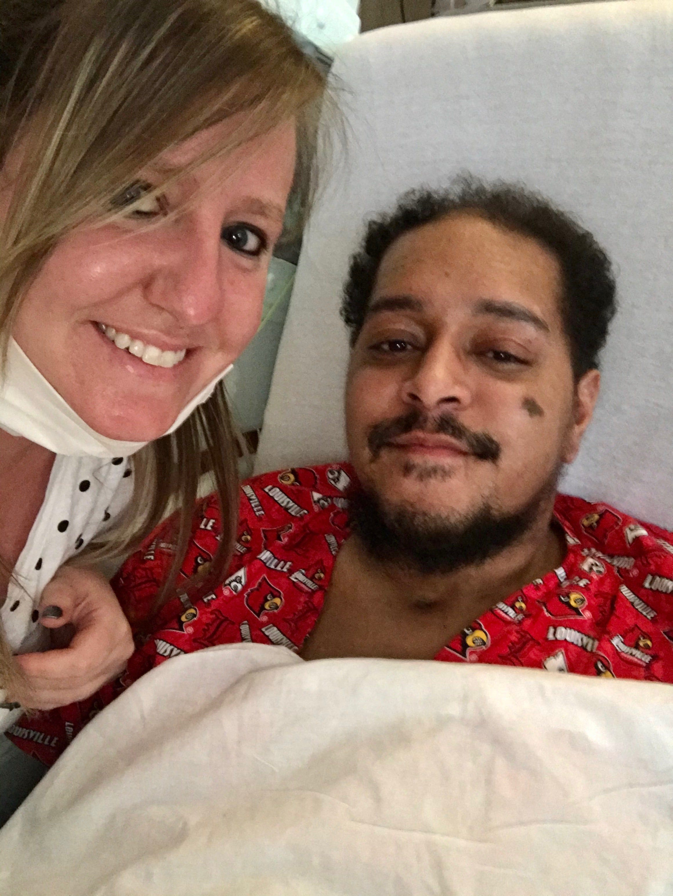 Demetrius Booker takes a selfie with his girlfriend, Michelle Bair, just before being transferred from Kindred Hospital to Baptist Health Louisville.