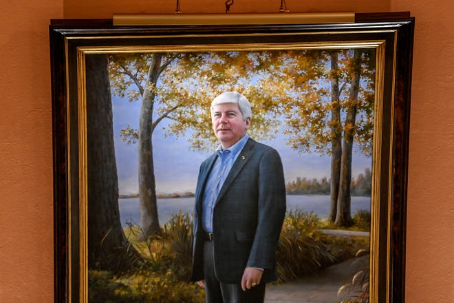 The painted portrait of former Gov. Rick Snyder hangs in the Capitol on Wednesday, Nov. 18, 2020, in Lansing. The portrait was painted by the Michigan State Capitol artist in residence and master decorative painter Joshua Risner. The painting was put up without any formal ceremony due to the pandemic.