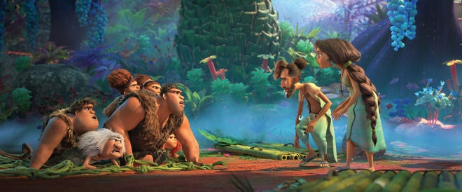 """The Croods, left, meet The Bettermans, right, in DreamWorks Animation's """"The Croods: A New Age."""""""