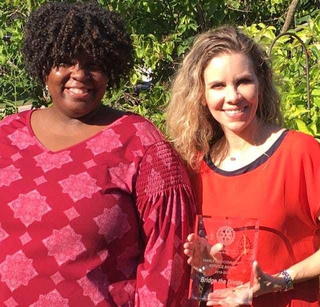 The Racism Reporting Hotline, a project of Bridge the Divide, is a way to confidentially report instances of racism, racial bullying, harassment, threats, intimidation and racial slurs in Ozaukee County, Pictured are executive director Erica Turner, left, and associate director Heidi Wheeler, both of Bridge the Divide.