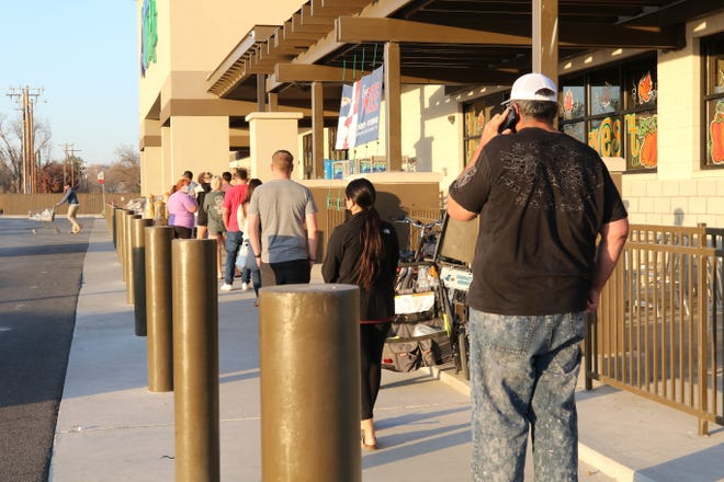 Shoppers line up outside the Carlsbad Albertsons Market the day the State of New Mexico orderd the grocery store close amid a statewide spike in COVID-19 infections, Nov. 18, 2020 in Carlsbad.