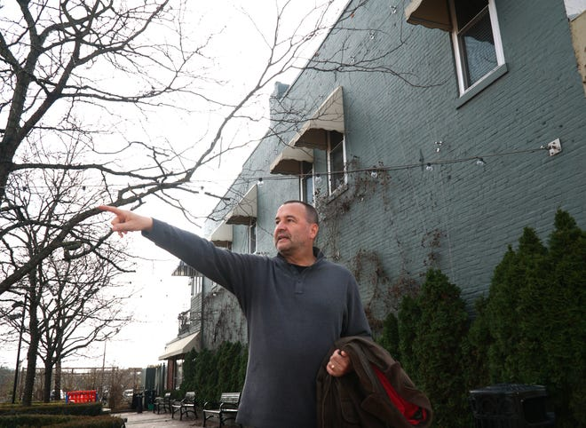 Manfred Schon points to where the 'Heat in the Street' structures will be placed in downtown Northville.