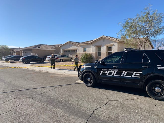 Forensic investigators are seen outside a Desert Hot Springs home where a man was fatally shot Wednesday, Nov. 18, 2020. Desert Hot Springs police say the man was a suspected home intruder and they're investigating if his death involved self-defense.