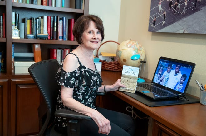 June Weiner, 72, used the extra time she had during the coronavirus pandemic to self-publish a novel. She is photographed with her book at home in Indio, Calif., on November, 18, 2020, just weeks before relocating to Florida.