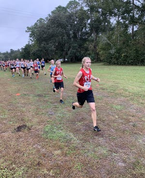 The Tutton sisters RaeAnne (first) and Jaimee (second) lead the pack in at the Region 1-1A cross country meet. RaeAnne and Jaimee were named PNJ Co-Cross Country Runners of the Year for 2020.